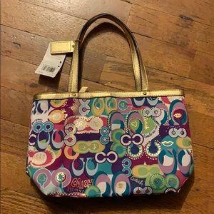 Small multicolored Coach purse